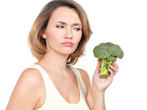 Beautiful young healthy woman holds broccoli. Stock Image