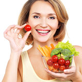 Beautiful young healthy woman with a plate of vegetables. Stock Photography