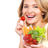 Beautiful young healthy woman with a plate of vegetables. royalty free stock photography