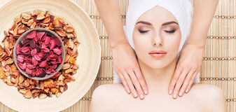 Beautiful, young and healthy woman in spa salon on bamboo mat. S Stock Photos