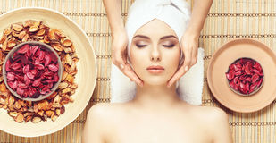 Beautiful, young and healthy woman in spa salon on bamboo mat. S Royalty Free Stock Image