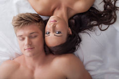 Beautiful young heterosexual couple in bed. Image of beautiful young heterosexual couple in bed, close-up Stock Images