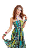 Beautiful young hippie woman in green dress Stock Photography