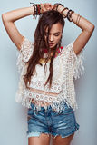 Beautiful young hippie woman. Portrait of beautiful young hippie woman in studio Royalty Free Stock Photo