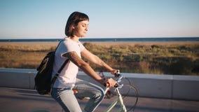 Brunette cycling in promenade