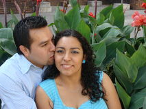 Beautiful Young hispanic Couple in Love. The boyfriend is giving a kiss to his girlfriend Royalty Free Stock Image