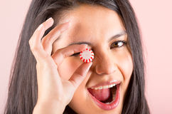 Beautiful young hispanic girl eating candy sweets Stock Photography