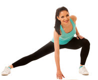 Beautiful young hispanic woman doing lunge exercise in fitness g Stock Image