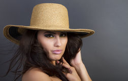 Beautiful Young Hispanic Woman Wearing Straw Hat Royalty Free Stock Photography
