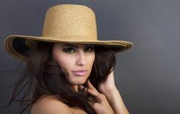 Beautiful Young Hispanic Woman Wearing Straw Hat Royalty Free Stock Photography