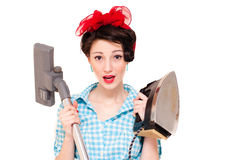 Beautiful young house wife with iron & vacuum cleaner on white Royalty Free Stock Photography