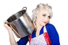 Beautiful young housewife holding kitchen utensils Stock Images
