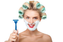 Beautiful young housewife is preparing for shaving Stock Image