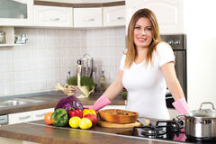 Beautiful young housewife serving lunch Royalty Free Stock Image