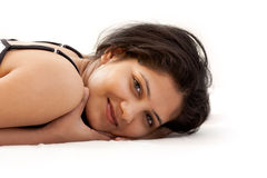 A beautiful young Indian girl on bed Royalty Free Stock Photos