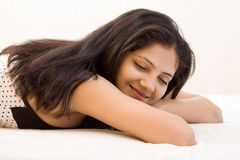 A beautiful young Indian girl taking rest Royalty Free Stock Photos