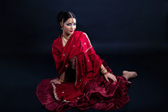 Beautiful young indian woman in traditional clothing. And indian accessories Stock Images