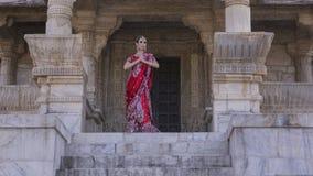 Beautiful young indian woman in traditional clothing with bridal. Beautiful Maharani Namaste. Young Indian Woman in Red bridal Sari clothing with bridal oriental Royalty Free Stock Photos