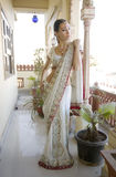 Beautiful young indian woman in traditional clothing with bridal Stock Photography
