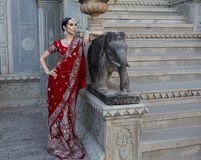 Beautiful young indian woman in traditional clothing with bridal Royalty Free Stock Photography