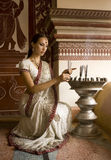 Beautiful young indian woman in traditional clothing with incens Stock Photo
