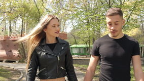Beautiful young inlove couple walking in park. Happiness and relationship. Young inlove couple stock footage