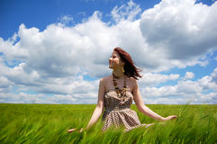 Beautiful young irl at green field Royalty Free Stock Photography