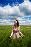 Beautiful young irl at green field Royalty Free Stock Images