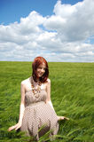 Beautiful young irl at green field Royalty Free Stock Image