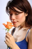Beautiful young Japanese girl smells a rose Stock Photography