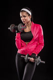 Beautiful young jogging woman exercises with dumbbells Isolated stock image