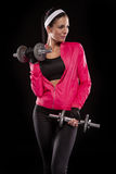 Beautiful young jogging woman exercises with dumbbells Isolated Royalty Free Stock Photos