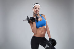 Beautiful young jogging woman exercises with dumbbells Isolated Stock Photography