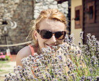 Beautiful young joyful woman posing with lavender flowers Royalty Free Stock Photography