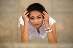 Beautiful young kazakh woman. In white dress Stock Image