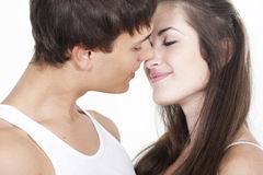 Beautiful young kissing couple Royalty Free Stock Photos