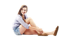Beautiful young lady with amazing smile. In summer clothes sitting down Stock Images
