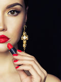 Beautiful young lady apply red lipstick Royalty Free Stock Photo