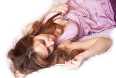 Beautiful young lady on the bed. Royalty Free Stock Photo