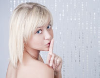 Beautiful young lady with blond hair Stock Photos