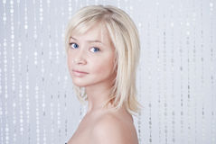 Beautiful young lady with blond hair Stock Image