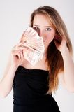 Beautiful young lady with cash Royalty Free Stock Photography