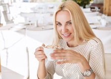 Beautiful young lady with cup of morning coffee cappuccino in ca Royalty Free Stock Photography