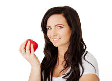 Beautiful young lady with delicious red apple Stock Photo
