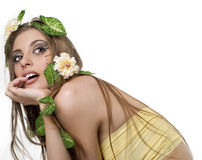 Beautiful young lady with flower and leaf Stock Images