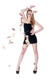 Beautiful young lady among flying cash Royalty Free Stock Photos