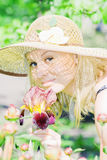 Beautiful young lady in the garden Royalty Free Stock Photos