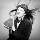 Beautiful young lady hiding present box in the form of heart Royalty Free Stock Images