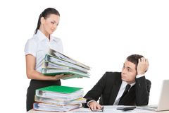 Beautiful young lady holding documents. Stressed businessman looking at documents with fear Stock Photo