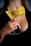 Beautiful young lady holding martini Stock Image